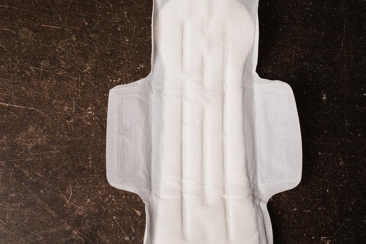 Female white hygienic pads on a dark marble background. Hygiene.